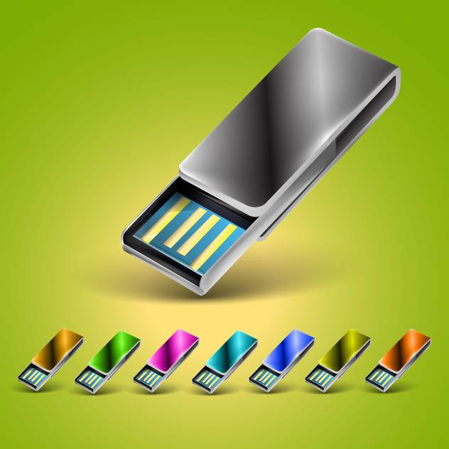 USB flash drives in different colors on green background - Free vector #132252